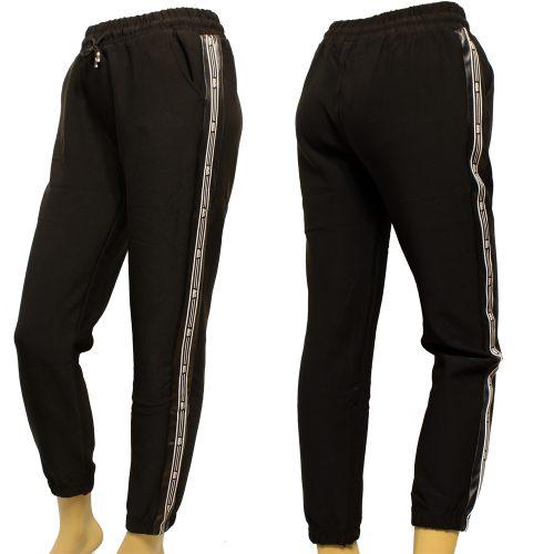 Дамски спортен панталон от еластичен полиестер. Стеснен модел с щрик